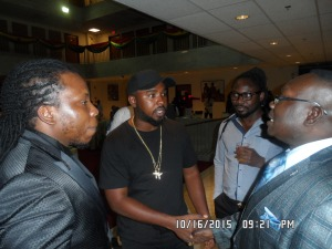 Edem, Gasmilla, and Kobby greeting one of the Award recipients, George Bright-Abu