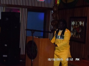 Obour speaking to the audience about Music and Tourism